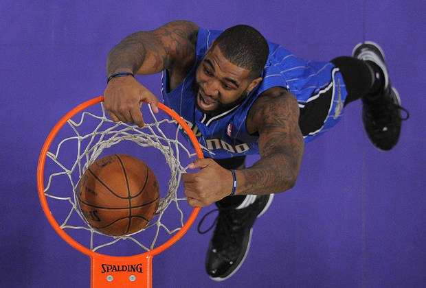 Orlando Magic forward Kyle O'Quinn dunks during the second half of their NBA basketball game against the Los Angeles Lakers, Sunday, Dec. 2, 2012, in Los Angeles. The Magic won 113-103. (AP Photo/Mark J. Terrill)