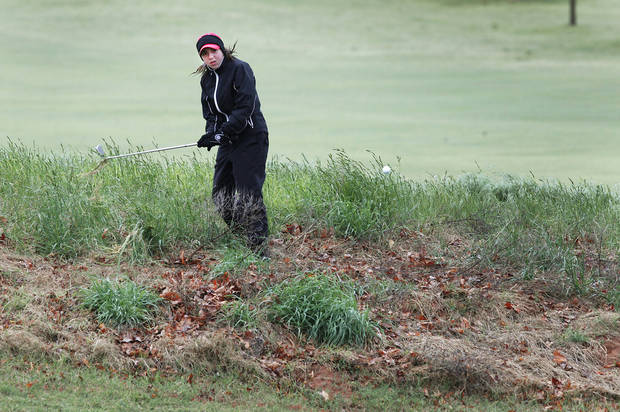 Tulsa Union's Trudy Allen hits out of the rough during the second day of Girls 6A golf tournament, Thursday, May 2, 2013. The players that tied yesterday play in a playoff due to the rain. Photo By David McDaniel/The Oklahoman