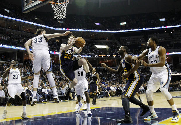 Utah Jazz's Gordon Hayward (20) and Al Jefferson (25) go to the basket against Memphis Grizzlies center Marc Gasol (33), of Spain, and forward Rudy Gay (22) in the first half of an NBA basketball game, Monday, Nov. 5, 2012, in Memphis, Tenn. (AP Photo/Lance Murphey)