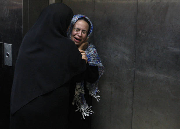 A Palestinian woman cries at a hospital in Gaza City, Saturday, Nov. 10,2012. An explosion targeted an Israeli military vehicle on Jewish state�s border with Gaza on Saturday and Israeli troops fired into the Palestinian territory, killing several civilians and wounding at least 25, Gaza officials and witnesses said. (AP Photo/Hatem Moussa)