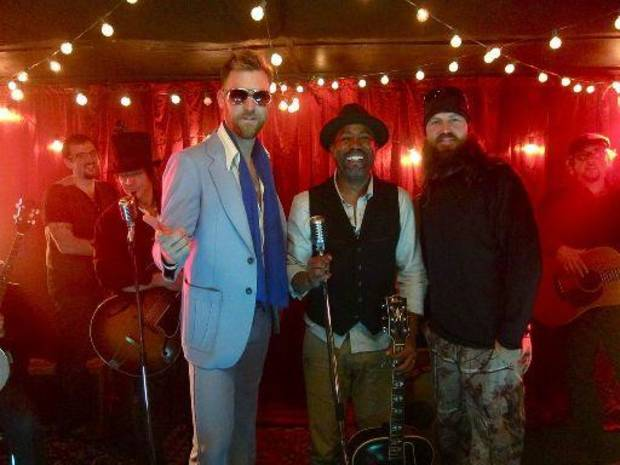 "From left, Charles Kelley of Lady Antebellum, Darius Rucker and Jase Robertson of A&E's ""Duck Dynasty"" appear in Rucker's video for ""Wagon Wheel.""            Photo Credit: Joanna Carter"