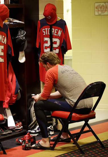 Washington Nationals relief pitcher Drew Storen sits by his locker after Game 5 of the National League division baseball series against the St. Louis Cardinals on Saturday, Oct 13, 2012, in Washington. St. Louis won 9-7. (AP Photo/Pablo Martinez Monsivais)