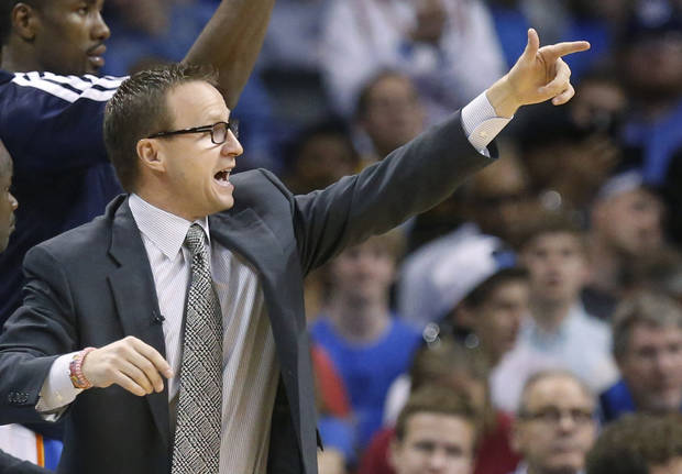 Oklahoma City Thunder head coach Scott Brooks shouts in the fourth quarter of an NBA basketball game against the Los Angeles Clippers in Oklahoma City, Sunday, Feb. 23, 2014. Los Angeles won 125-117. (AP Photo/Sue Ogrocki)