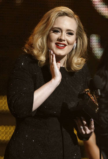 "Adele accepts the award for best pop solo performance for ""Someone Like You"" during the 54th annual Grammy Awards on Sunday, Feb. 12, 2012 in Los Angeles. (AP Photo/Matt Sayles) ORG XMIT: CASH284"