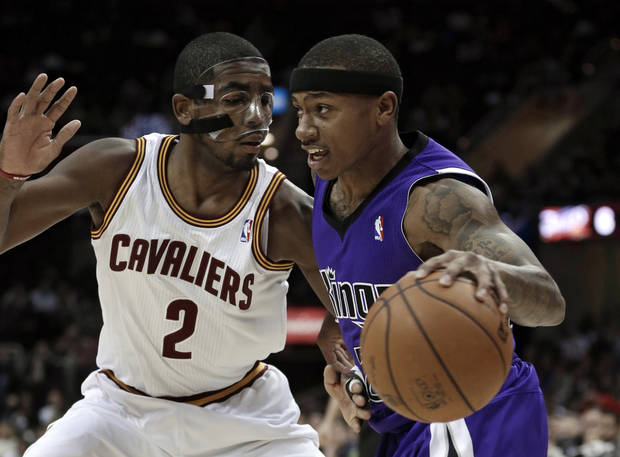 Sacramento Kings' Isaiah Thomas, right, drives past Cleveland Cavaliers' Kyrie Irving during the first quarter of an NBA basketball game on Wednesday, Jan. 2, 2013, in Cleveland. (AP Photo/Tony Dejak)