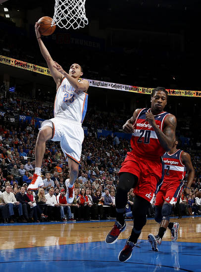 Oklahoma City's Kevin Martin (23) goes to the basket past Washington's Cartier Martin (20) during an NBA basketball game between the Oklahoma City Thunder and the Washington Wizards at Chesapeake Energy Arena in Oklahoma City, Wednesday, March 19, 2013. Oklahoma City won 103-80. Photo by Bryan Terry, The Oklahoman