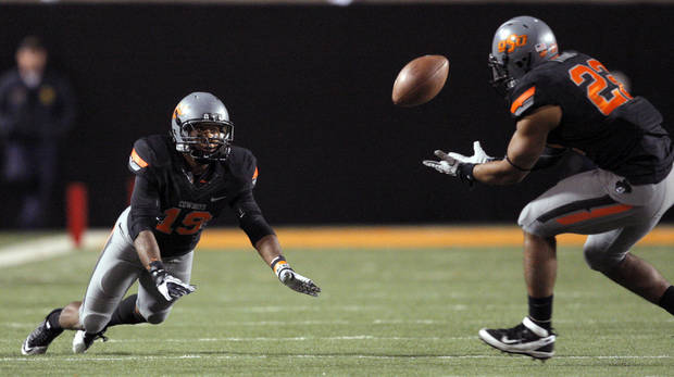 Oklahoma State's James Thomas (22) catches a pass tipped by Brodrick Brown (19) during a college football game between the Oklahoma State University Cowboys (OSU) and the Kansas State University Wildcats (KSU) at Boone Pickens Stadium in Stillwater, Okla., Saturday, Nov. 5, 2011.  Photo by Sarah Phipps, The Oklahoman