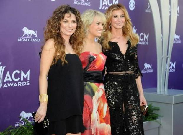 From left, singers Shania Twain, Carrie Underwood and Faith Hill arrive at the 48th Annual Academy of Country Music Awards at the MGM Grand Garden Arena in Las Vegas on Sunday, April 7, 2013. (AP photos)