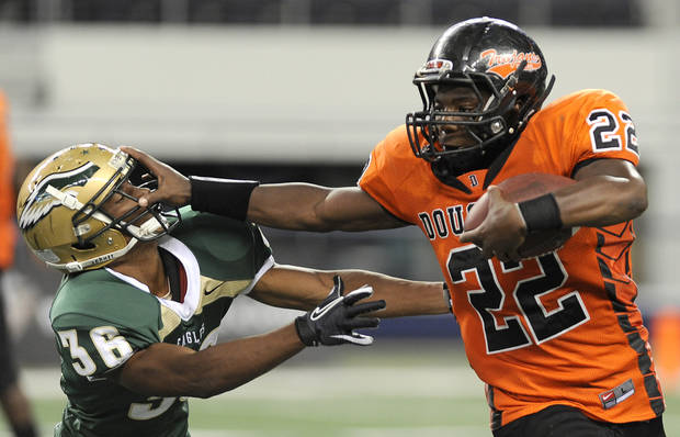 in the second half during the high school football game between Douglass and DeSoto, Monday, Sept. 5, 2011, at Cowboys Stadium in Arlington, Texas. (Matt Strasen/Special Contributor)