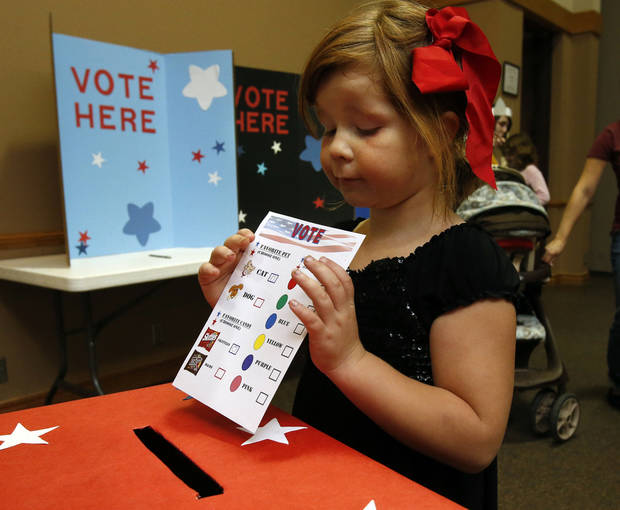 Isabella Borg, 5, casts her vote as she participates in an election-day party.