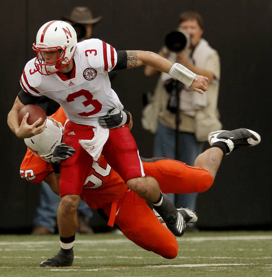 Nebraska's Taylor Martinez tries to get by OSU's Jamie Blatnick during the college football game between the Oklahoma State Cowboys (OSU) and the Nebraska Huskers (NU) at Boone Pickens Stadium in Stillwater, Okla., Saturday, Oct. 23, 2010. Photo by Bryan Terry, The Oklahoman