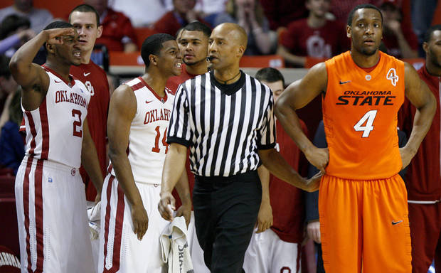 Oklahoma's Steven Pledger (2) and Carl Blair (14) celebrate beside Oklahoma State's Brian Williams (4) during the Bedlam men's college basketball game between the University of Oklahoma Sooners and the Oklahoma State Cowboys in Norman, Okla., Wednesday, Feb. 22, 2012. Oklahoma won 77-64. Photo by Bryan Terry, The Oklahoman