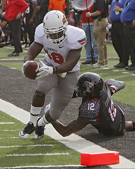 Oklahoma State's Herschel Sims (18) runs past Texas Tech Red Raiders safety D.J. Johnson (12) during the college football game between the Oklahoma State University Cowboys (OSU) and Texas Tech University Red Raiders (TTU) at Jones AT&T Stadium on Saturday, Nov. 12, 2011. in Lubbock, Texas.  Photo by Chris Landsberger, The Oklahoman  ORG XMIT: KOD
