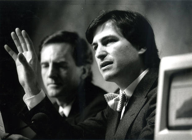 John Sculley (left) and Steve Jobs of Apple Computers speak at a press conference following the annual shareholders meeting on Jan. 23, 1985.