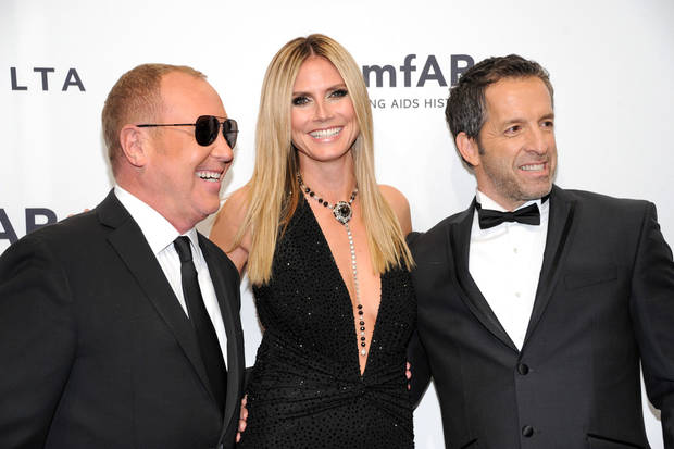 Designer Michael Kors, left, poses with honorees Heidi Klum and Kenneth Cole at amfAR&#039;s New York gala at Cipriani Wall Street on Wednesday, Feb. 6, 2013 in New York. (Photo by Evan Agostini/Invision/AP)