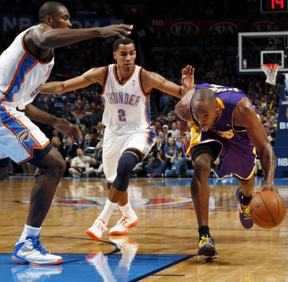 Los Angeles' Kobe Bryant (24) drives the ball between Oklahoma City's Thabo Sefolosha (2) and Serge Ibaka (9) during an NBA basketball game between the Oklahoma City Thunder and the Los Angeles Lakers at Chesapeake Energy Arena in Oklahoma City, Friday, Dec. 7, 2012. Oklahoma City won, 114-108. Photo by Nate Billings, The Oklahoman