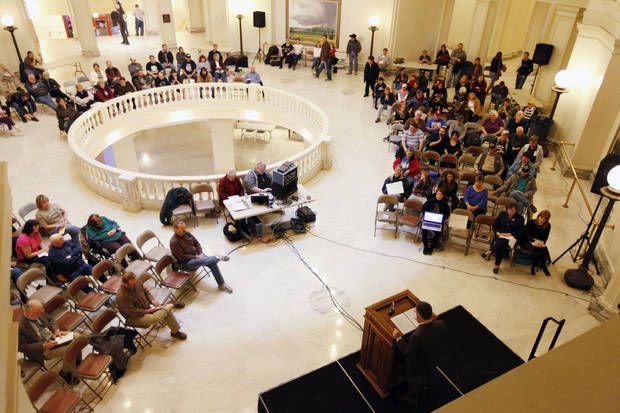 Concerned people listen Saturday as Oklahoma American Civil Liberties Union Director Ryan Kiesel speaks during a 4th Amendment rights rally in the rotunda of the state Capitol. Photos by Paul Hellstern, The Oklahoman