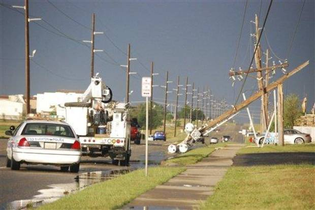 Downed  power poles are seen on the east side of Lawton after a storm Monday. Winds of 65 mph were clocked nearby in Fletcher and hail up to tennis-ball size was reported.  (AP Photo/The Constitution, Jeff Dixon)