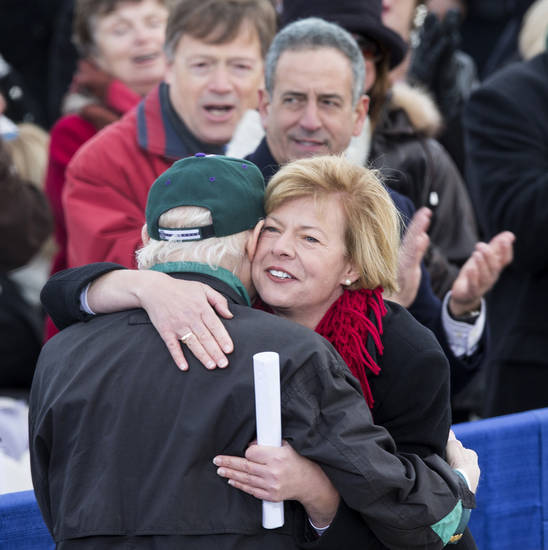 Wisconsin Democratic Senate candidate, Rep. Tammy Baldwin, D-Wis. hugs retiring Wisconsin Sen. Herb Kohl before President Barack Obama's campaign stop in Green Bay, Wis., Thursday, Nov. 1, 2012. Former Wisconsin Sen. Russ Feingold applauds behind Baldwin. (AP Photo/Tom Lynn)