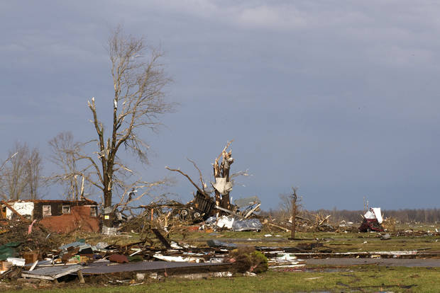 Residents of Marysville, Ind., survey the tornado damage to their homes Friday, March 2, 2012 in Marysville, Ind. Powerful storms stretching from the U.S. Gulf Coast to the Great Lakes in the north wrecked two small towns, killed at least three people and bred anxiety across a wide swath of the country on Friday, in the second deadly tornado outbreak this week. (AP Photo/Brian Bohannon) ORG XMIT: KYBB108