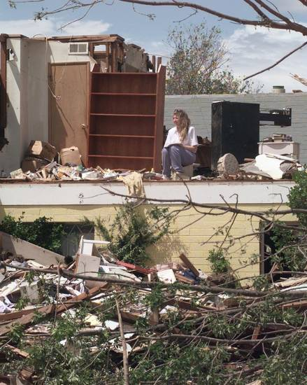 MAY 3, 1999 TORNADO: Tornado victims, damage: Woman working on inventorying things in a  demolished  upstairs room in a house in Moore. The bookcase was made by her father who is deceased. Goes with Baldwin/DeFrange story (BALWIN HAS I.D.s)