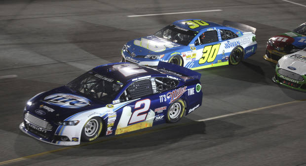 Brad Keselowski (2) runs in Turn 4 near David Stremme (30) during the NASCAR Sprint Cup Series auto race at Richmond International Raceway in Richmond, Va., Saturday, Sept. 7, 2013.  (AP Photo/Zach Gibson)