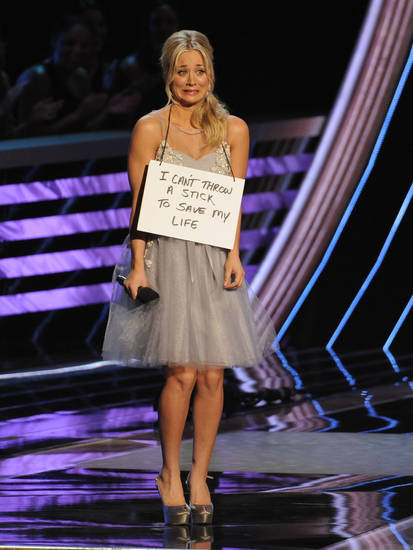Host Kaley Cuoco is seen on stage at the People�s Choice Awards at the Nokia Theatre on Wednesday Jan. 9, 2013, in Los Angeles. (Photo by Chris Pizzello/Invision/AP)