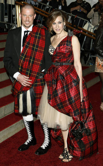 In this Monday, May 1, 2006 file picture, designer Alexander McQueen poses with Sarah Jessica Parker during arrivals at the Costume Institute Gala at the Metropolitan Museum of Art in New York. The Costume Institute of The Metropolitan Museum of Art will honor the memory _ and the fashion vision _ of the late designer Alexander McQueen through a retrospective exhibit in 2011. (AP Photo/Stuart Ramson) ORG XMIT: NYLS539
