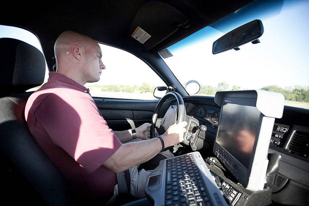 Sgt. Keith Cornman drives through a training driving course at the Oklahoma County Field Training Center. Photo by SARAH PHIPPS, THE OKLAHOMAN
