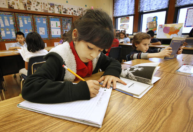 "Third-grader Kelcy Garcia, 8, works on a reading assignment from the book ""Stone Fox"" at Sequoyah Elementary in northwest Oklahoma City. <strong>PAUL B. SOUTHERLAND - THE OKLAHOMAN</strong>"