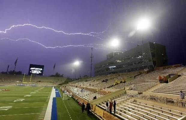 Lightning streaks across the sky during a weather delay before a college football game between the Oklahoma State University Cowboys (OSU) and the University of Tulsa Golden Hurricane (TU) at H.A. Chapman Stadium in Tulsa, Okla., Saturday, Sept. 17, 2011. Photo by Nate Billings, The Oklahoman.
