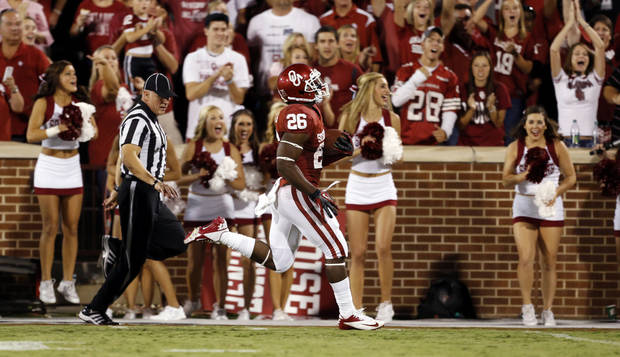 Damien Williams (26) scores on a long rushing play during the second half of the college football game between the University of Oklahoma Sooners (OU) and Florida A&M Rattlers at Gaylord Family�Oklahoma Memorial Stadium in Norman, Okla., Saturday, Sept. 8, 2012. Photo by Steve Sisney, The Oklahoman