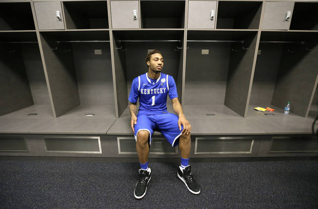 Kentucky guard James Young sits in the locker room after his team's 60-54 loss to Connecticut in the NCAA Final Four tournament college basketball championship game Monday, April 7, 2014, in Arlington, Texas. (AP Photo/Eric Gay)