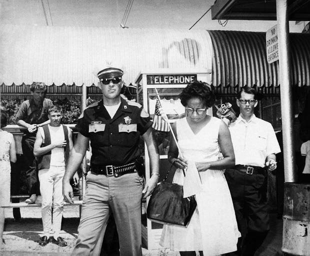Mrs. Clara Luper of Oklahoma City and other demonstrators outside the privately-owned Doe Doe Amusement Park in Lawton, Okla.  Demonstrators protested a segregation policy barring blacks from the park's swimming pool. Staff photo take June 11, 1966.
