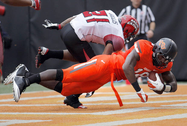 Oklahoma State's Blake Jackson (18) scores a touchdown as Louisiana-Lafayette's Rodney Gillis (21) defends during a college football game between Oklahoma State University (OSU) and the University of Louisiana-Lafayette (ULL) at Boone Pickens Stadium in Stillwater, Okla., Saturday, Sept. 15, 2012. Photo by Sarah Phipps, The Oklahoman