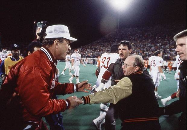 UNIVERSITY OF OKLAHOMA/OKLAHOMA STATE: OU head college football coach Barry Switzer and OSU head football coach Pat Jones shake hands following Saturday night's classic Bedlam football contest.   Staff photo by Paul Hellstern taken 11-6-88; photo ran in the 11-7-88 Daily Oklahoman.