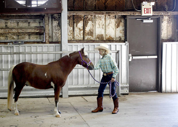 Cassidy Mulligan, 11, works with Vivace during the Cleveland County Free Fair Horse Show at the Cleveland County County Fair Barn, Saturday, Aug. 28, 2010, in Norman, Okla. Photo by Sarah Phipps, The Oklahoman