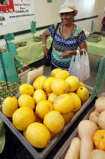 Mwena Baker, of Norman, shops for produce Wednesday at the Norman Farm Market. PHOTO BY STEVE SISNEY, THE OKLAHOMAN <strong>STEVE SISNEY</strong>