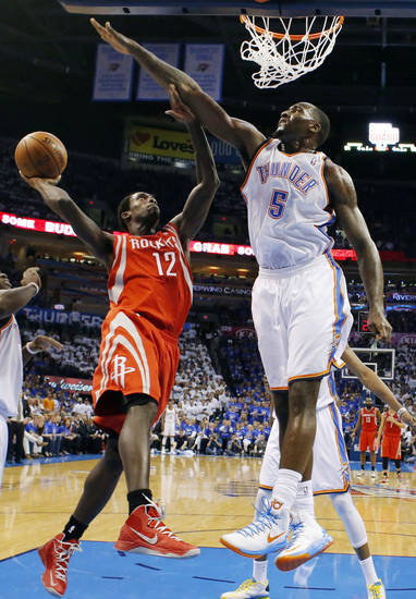 Oklahoma City's Kendrick Perkins (5) defends Houston's Patrick Beverley (12) during Game 2 in the first round of the NBA playoffs between the Oklahoma City Thunder and the Houston Rockets at Chesapeake Energy Arena in Oklahoma City, Wednesday, April 24, 2013. Photo by Nate Billings, The Oklahoman