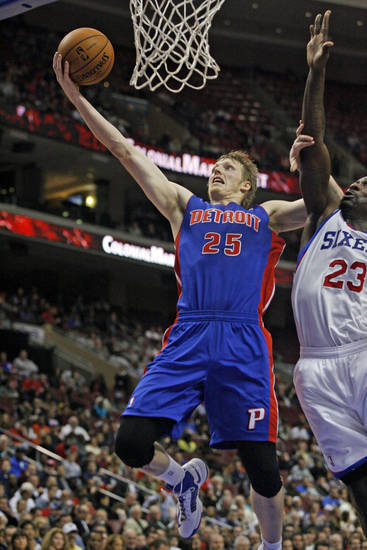 Detroit Pistons' Kyle Singler (25) scores as Philadelphia 76ers' Jason Richardson (23) defends in the first half of an NBA basketball game Wednesday Nov. 14, 2012 in Philadelphia. (AP Photo/ H. Rumph Jr)