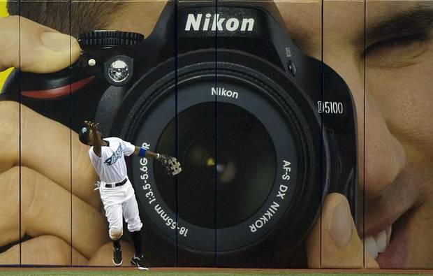 Toronto Blue Jays center fielder Corey Patterson reaches for a bouncing ball hit for a double by Detroit Tigers' Brandon Inge during the ninth inning of a baseball game in Toronto on Friday, May 6, 2011. (AP Photo/The Canadian Press, Nathan Denette) ORG XMIT: NSD113