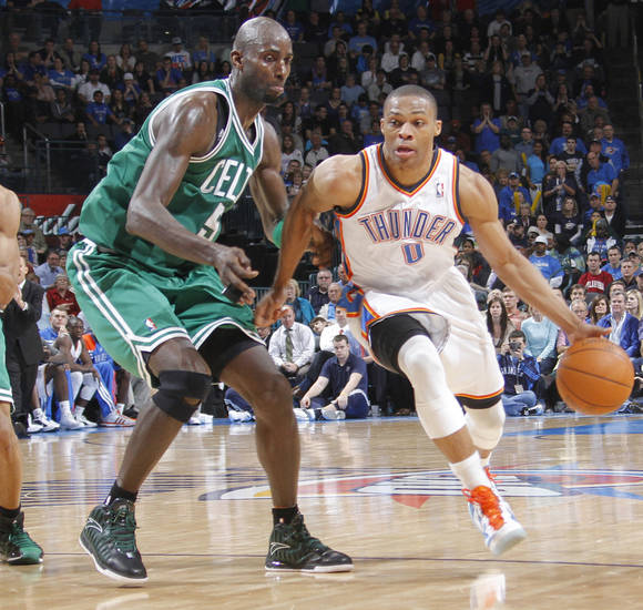 during the NBA basketball game Oklahoma City Thunder point guard Russell Westbrook (0) drives past Boston Celtics power forward Kevin Garnett (5) between the Oklahoma City Thunder and the Boston Celtics at the Chesapeake Energy Arena on Wednesday, Feb. 22, 2012 in Oklahoma City, Okla.  Photo by Chris Landsberger, The Oklahoman
