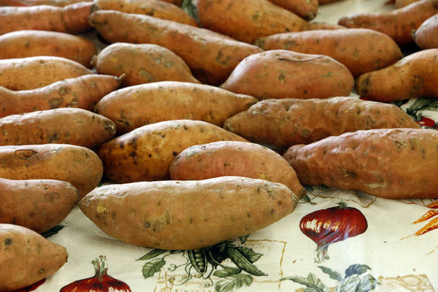 Rows of sweet potatoes are lined up for shoppers at the Norman Farm Market.