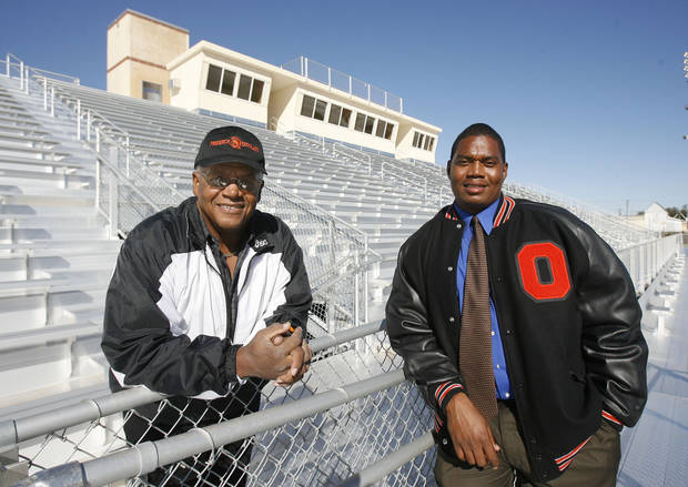 Former Douglass High School Head Football Coach Stanford White (left) and current Coach Willis Alexander stand in the bleachers of the new Douglass High School Stadium in Oklahoma City, Okla., Tuesday, October 23, 2007. Photo by Paul Hellstern / The Oklahoman. ORG XMIT: KOD