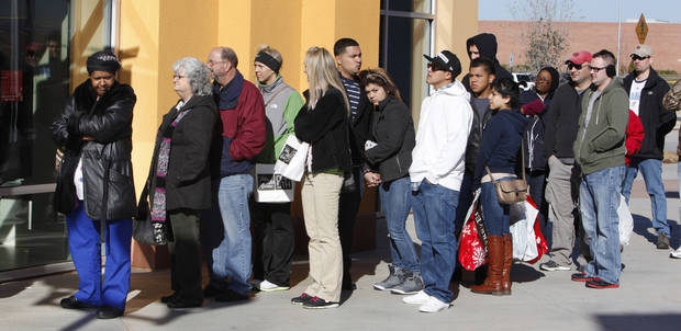 Christmas shoppers wait in line to enter the Coach Factory at The Outlet Shoppes of Oklahoma City in Oklahoma City Friday, Dec, 23, 2011. Photo by Paul B. Southerland, The Oklahoman