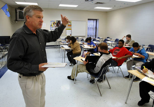 Randy Atkins, principal at Western Heights Middle School teaches a vocabulary improvement class as his school kicks off its first day of training  for its One Kid Challenge program on Saturday, Dec. 15, 2012, in Oklahoma City, Okla.  Photo by Steve Sisney, The Oklahoman