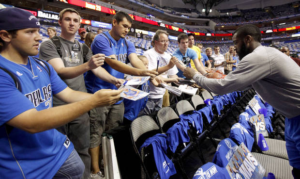 Oklahoma City's James Harden (13) signs autographs before game 5 of the Western Conference Finals in the NBA basketball playoffs between the Dallas Mavericks and the Oklahoma City Thunder at American Airlines Center in Dallas, Wednesday, May 25, 2011. Photo by Bryan Terry, The Oklahoman
