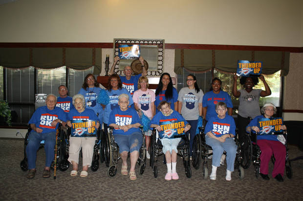 Staff and residents of Grace Living Center Brookwood prepare to Thunder Up on Thursday for the next game of the NBA finals.