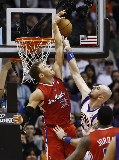 Los Angeles Clippers' Blake Griffin (32) blocks the shot of Phoenix Suns' Marcin Gortat (4), of Poland, during the first half in an NBA basketball game on Thursday, Jan. 24, 2013, in Phoenix. (AP Photo/Ross D. Franklin)