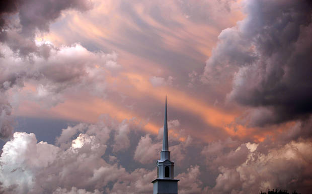 Storm clouds swirl around the Cross Pointe Church steeple in Norman, Okla., Wednesday, May 19 2010. Photo by Sarah Phipps, The Oklahoman